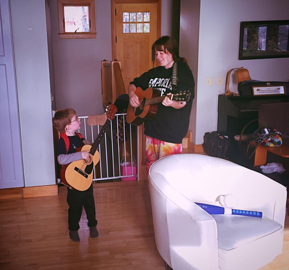 Playing guitar with nephew